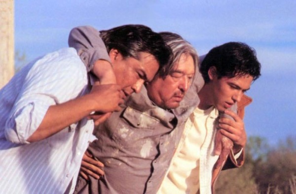 Grahame Greene (center) as Mogie Yelllow Lodge gets some help from Eric Schweig (left, as Rudy Yello